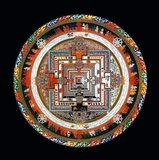 Kalachakra (Sanskrit: कालचक्र; IAST: Kālacakra; Telugu: కాలచక్ర Tibetan: དུས་ཀྱི་འཁོར་ལོ།; Wylie: Dus-kyi 'khor-lo; Mongolian: Цогт Цагийн Хүрдэн: Tsogt Tsagiin Hurden; Chinese: 時輪) is a Sanskrit term used in Tantric Buddhism that literally means 'time-wheel' or 'time-cycles'.<br/><br/>  The Kalachakra tradition revolves around the concept of time (kāla) and cycles (chakra): from the cycles of the planets, to the cycles of human breathing, it teaches the practice of working with the most subtle energies within one's body on the path to enlightenment.<br/><br/>  The Kalachakra deity represents a Buddha and thus omniscience. Since Kalachakra is time and everything is under the influence of time, Kalachakra knows all. Whereas Kalachakri or Kalichakra, his spiritual consort and complement, is aware of everything that is timeless, untimebound or out of the realm of time. In Yab-yum, they are temporality and atemporality conjoined. Similarly, the wheel is without beginning or end.